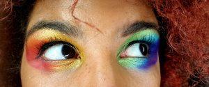Ngaio Anyia's eyes painted with rainbow eyeshadow